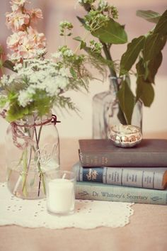 I will be using old books like this for centerpieces.  I like the mason jars with the assortment of flowers and leaves.