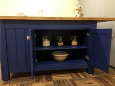 Freestanding Kitchen Island with 3 Drawers, Bookcase & Double Storage Cupboard. The oak worktop overhangs along one whole side & one end to allow for seating around half of the island. The 3 drawers are fitted on soft-close runners & each cupboard contains an adjustable shelf. Any size or colour can be made to order. Size shown here is W:1800mm H:910mm D:1200mm & paint colour is Dulux 'Saphire Salute'. Worktop is oiled 40mm staved rustic oak but other timbers are available. Kitchen Island With Drawers, Kitchen Islands, Freestanding Kitchen, Cupboard Storage, Adjustable Shelving, Runners, Entryway Tables, Cabinets, Kitchen Design