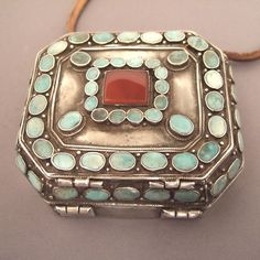 "Silver, turquoises, carnelian, Turkmenistan   Description:   One of the finest kind of travel boxes found by me for long time: beautiful patina, turquoise and carnelian of very fine quality, strength and perfection of the way the box is built with two large rivets based in the mass ... this object for me, is a model of its kind!   Weight:260,8gr   Width:3,54inch   Length:3,93inch   www.halter-ethnic.com see ""My Finds"" and of course in my Gallery!"