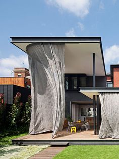 Free flowing and kinetic metal mesh curtain wraps around Hiro-En House