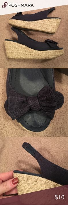 Lightly worn navy bow wedges Lightly worn navy and twine wedges, they have and elastic strap that holds them into place and a cute rounded bow at the toe! Rampage Shoes Wedges