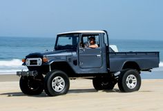 The beach, a restored Toyota truck... This could be Bo.