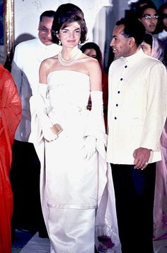Jackie Kennedy photographed by Arthur Rickerby in a gown and pearls while visiting India in March of 1962.