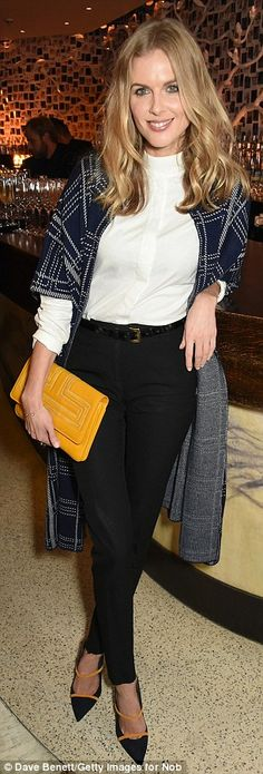 Bang on-trend:Donna, who is dating Catherine, Duchess of Cambridge's brother James Middleton, added a splash of colour to the look with a bright yellow clutch bag with black heels boasting orange piping