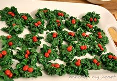 Holly. Rice Krispy Treats, but with corn flakes and green dye in the marshmallows. Topped with red hots.