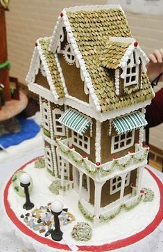 Elaborate and detailed Gingerbread House with white chocolate trim and pumpkin seed shingles! Cake Wrecks - Home - Sunday Sweets: Gorgeous Gingerbread Easy Gingerbread House, Gingerbread House Designs, Gingerbread Village, Gingerbread Cookies, Cookie House, House Cake, Christmas Baking, Christmas Cookies, Ginger House