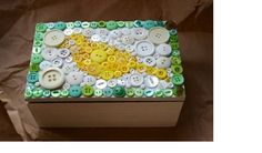 plain box decorated with buttons on top into a cute design!