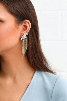 The Greatest Fan Gold Rhinestone Earrings are sure to wow! Stunning, clear marquis rhinestone earrings with gold chains.