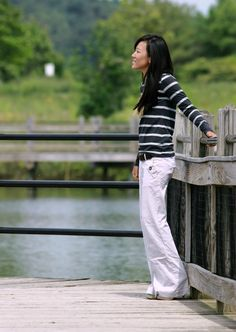 Grand Rapids lifestyle, style and fashion blogger and designer - Wetland Park Boardwalks; her - grey striped linen trousers, grey striped shirt