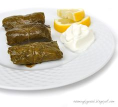The Greek festival is in town and I had DOLMADES (grape leaves stuffed with rice) for lunch. Well now, I have grape leaves, I have mint, I have dill so I have to make DOLMADES!