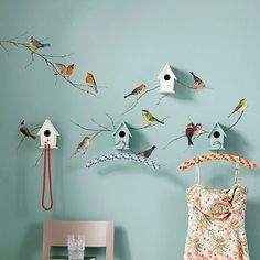 This is adorable!  Cute little birdie decals + cute little birdhouses + pretty blue walls!