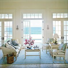 A calm color palette of neutrals and pale blues keeps the ocean view the focus of this room. | Coastalliving.com