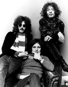 Cream -- Eric Clapton (guitar, vocals), Jack Bruce (bass, better vocals), and Ginger Baker (drums). The first and prototypical power trio.
