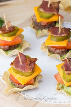 Tostitos Appetizer Sliders; crispy scoops filled with guacamole, then topped with burger, cheese, tomato, pickle and bacon!