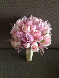 This is a combination of flowers in pink like cymbidium, tulips and hyacinth with astilbe in pink as  filler. KRISTEL is the name of this simple bouquet,www.sergeigonia.com