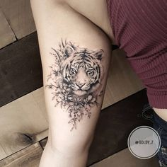 Floral tiger tattoo on arm by @goldy_z