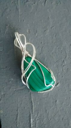 Etsy listing at https://www.etsy.com/listing/246525971/malachite-pendant-sterling-wire-wrapped