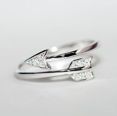 Sterling Silver Cupid Arrow Ring https://style-restyle.myshopify.com/collections/rings/products/sterling-silver-cupid-arrow-crystal-zircon-ring