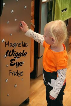 """Magnetic Wiggle Eye Fridge - Add some """"spook"""" to your kitchen this Halloween with this simple idea! Stick some magnets to the back of wiggle eyes to create a fun play experience for the kiddos. They will love it! {BitznGiggles.com}"""