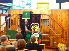 Rev. Steven Wild with his helpers, and two frogs! Fore Street Methodist Church, St Ives Cornwall.