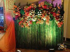 Amazing backdrop idea all plants bamboo philodendrons and photo of decor splendor weddings and celebrations via junglespirit Choice Image