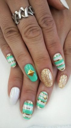 Green and white stud nail art