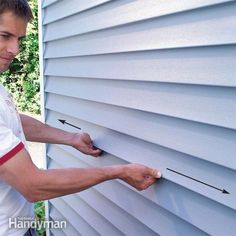 Vinyl siding will pop and crackle with every change of sunlight and temperature if nailed incorrectly. Here& how to fix the problem if you have it, and how to nail (or renail) siding so that it moves freely and silently for the life of your house. Home Renovation, Vinyl Siding Repair, Vinyl Siding Installation, Family Handyman Magazine, Vinyl Replacement Windows, Siding Replacement, Diy Home Repair, House Siding, Wood Siding