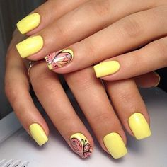 Really cute and simple butterflies nail art. The pale yellow base color helps highlight the colorful butterfly design on top that spans its wings covering the entire nail.