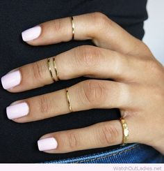 Simple white nail polish with nice gold rings