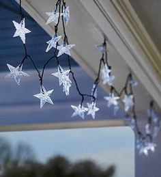These Star String Lights hung from the ceiling and covered by a gauze drop would look like a soft summer night on a sleeping porch.