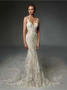 Floral, baroque lace with thousands of hand-embroidered beads and paillettes sparkles over delicate french chantilly lace, curving gracefully around the body to contour and elongate the silhouette. Figure-flattering, deep side cutouts reveal a subtle hint of skin, while a double layer, sculpted baroque lace train completes this dramatic look. Lace Mermaid Wedding Dress, Sexy Wedding Dresses, Mermaid Dresses, Designer Wedding Dresses, Bridal Dresses, Wedding Dress Trumpet, Prom Dresses, Formal Dresses, Allure Bridals
