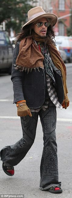 3/25/15-The singer wore a typically eccentric outfit as he visited his family in New York's West Village