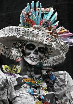 A woman dressed as the iconic Mexican 'Catrina' poses for photographers as she gathers with other women in costume in an attempt to set a record for the most Catrinas in one place during Day of the Dead celebrations in Mexico City.