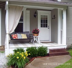 I'm a huge fan of curtains on the porch. And I'm kind of drooling over the striped porch floor!!