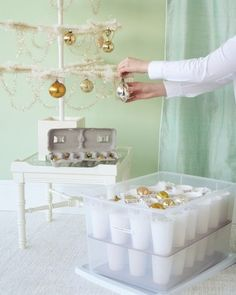 """Ornament Storage"" - Styrofoam cups stacked on cardboard dividers in a plastic storage tub is an excellent way to store your ornaments."