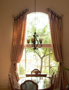window treatment idea showing decorative curtain rods for arched windows