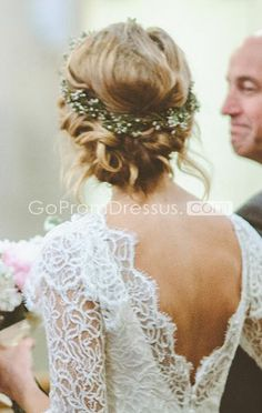 i like this but I wonder what it looks like from the front. also, it looks like a gown for an indoor church wedding.