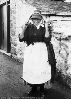 Penzance, Fishwife 1890. The wicker basket is called a cowal. Older fishwives would walk for miles carrying their cowals until the contents were all sold. Younger fishwives did not sell fish, but helped with the cleaning and salting of the catch. #Penzance #Cornwall