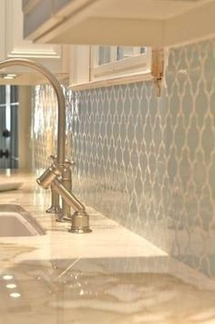 Pale blue Moroccan tile backsplash with white grout. I like colored tile w/white grout or white tile w/colored grout. I love a basically all white kitchen...so clean and bright.  I AM getting the refrigerator/freezer side by side wood paneled to match the cabinets❣   ~❥