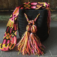 DESCRIPTION  This Beautiful and unique Morral Bag is an Otomiartesanal exclusive design, proudly hand woven by Mexican Artisans from Mayan Zone. This Pouch has been Inspired in the beautiful Wayuu bag from Colombia and Venezuela.  The Mayan Morral Strap has an amazing colorful design
