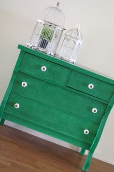 emerald green dresser~~~~loving the textured paintable wallpaper that was used on the drawer fronts