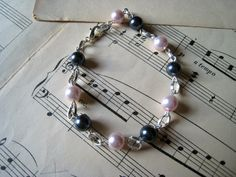 Cute cream and black pearl bracelet with silver chain. Love it! #pearl #silver #jewelry #dteam