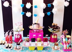This ice cream party was held inside a cupcake shop.  I love how simple items, like metal pails, are used to raise cake stands and give dimension.  These are the kinds of parties we want at Katie Bakes!  Fun, fun, fun!