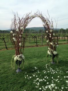 I like the loose structure and the sparse use of flowers. Don't know how I feel about the anchoring urns.