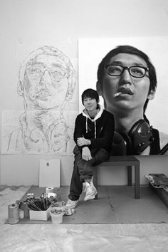 Kang, Kang-Hoon realist artist seated in front of his sketch and painting http://kangkanghoon.com
