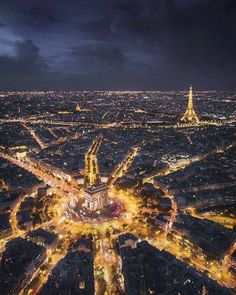Paris is the City of Lights, and you can really tell in this beautiful night aerial shot, including the wagon wheel of roads surrounding the Arc de Triomphe and the iconic Eiffel Tower in the distance. Source by theglobalgadabout Tour Eiffel, Paris Travel, France Travel, Aerial Photography, Travel Photography, France Photography, Photography Lighting, Landscape Photography, Photography Ideas