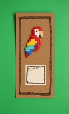 Items similar to Colorful pixel parrot badge gift on Etsy