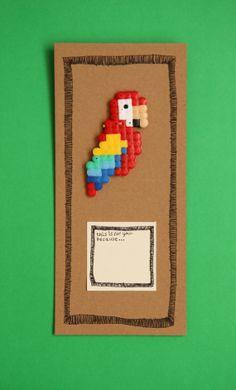 Hama bead parrot badge.