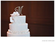White fondant cake with decorative fondant designs and gold accents | villasiena.cc