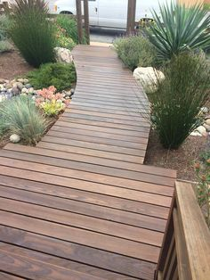 Ipe Wood Walkway Walkway built out of Ipe wood. Surrounded by beautiful landscaping. Modern Landscape Design, Modern Landscaping, Backyard Landscaping, Country Landscaping, Landscaping Ideas, Wood Pathway, Wooden Walkways, Ipe Wood Decking, Garden Stones